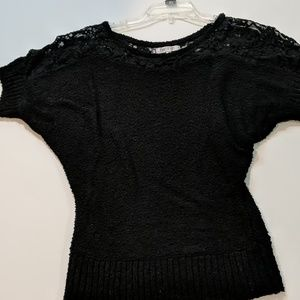 Jennifer Lopez black sweater with lace detail